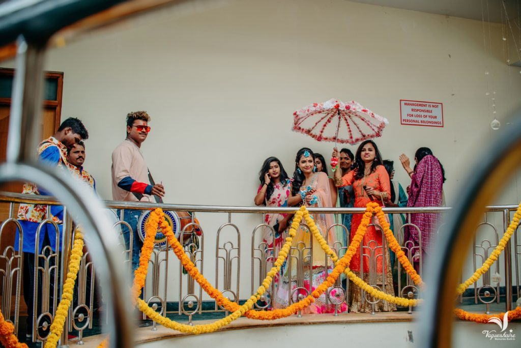 wedding umbrella,bridal entry ideas 2019,bride on horse,bride on bike,bride entry on bullet,bridal band,Red carpet